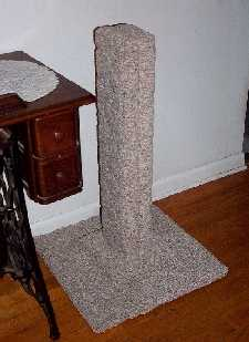 "30"" high heavy-duty berber scratching post on an all-wood frame"